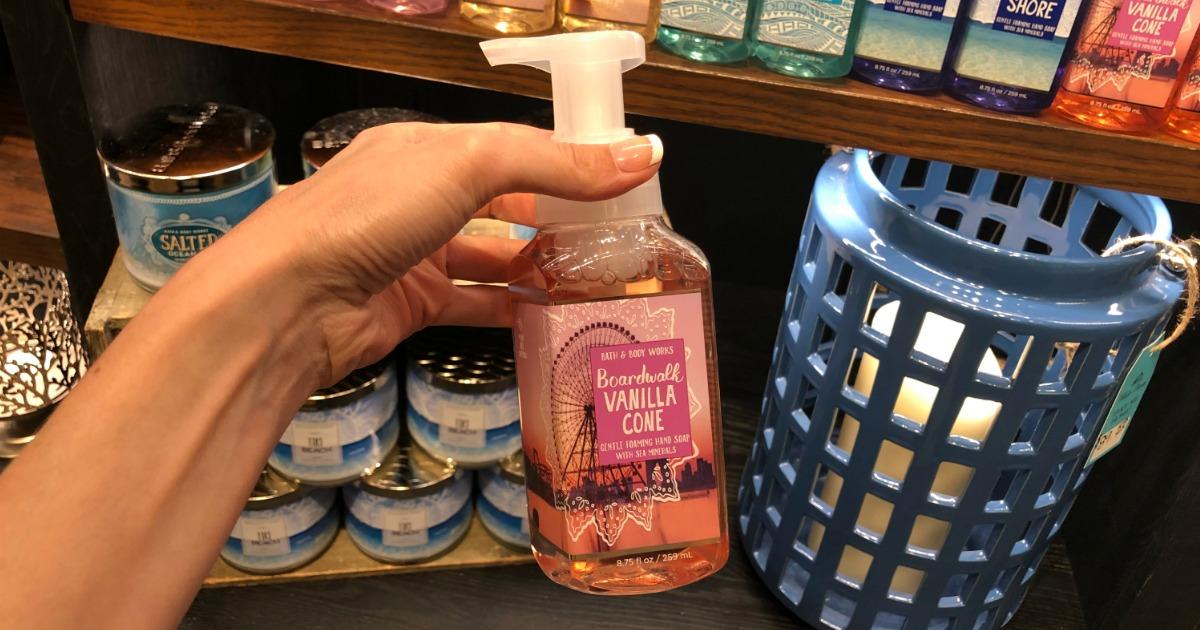 Woman holding Bath & Body Works Boardwalk Vanilla Cone Hand Soap