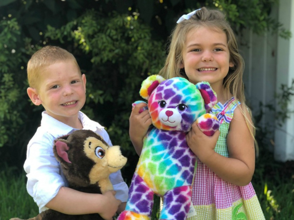boy and girl holding Build-A-Bear stuffed animals