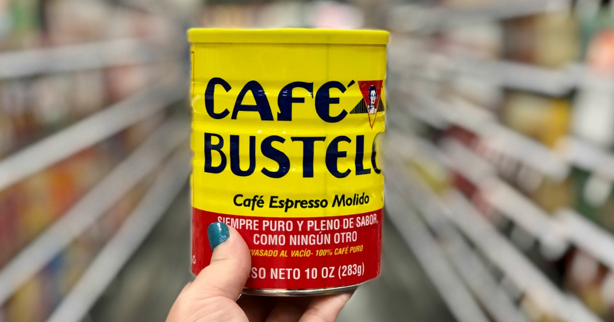 hand holding cafe bustelo coffee can with blurred background