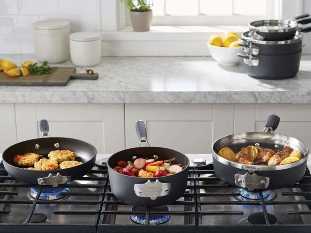 Calphalon Select 9pc Space Saving Hard-Anodized Nonstick Cookware Set on stove top in kitchen