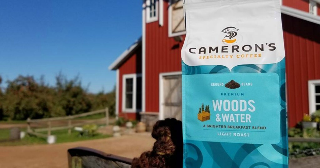 camerons coffee sitting on fence post at farm