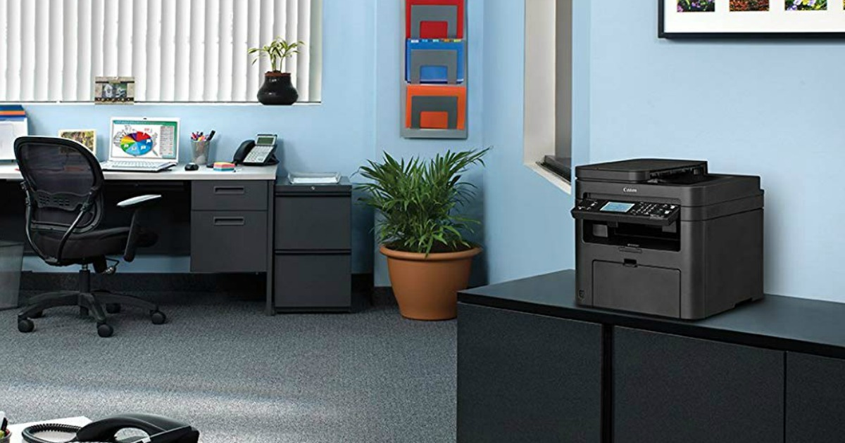 Canon printer on desk in office