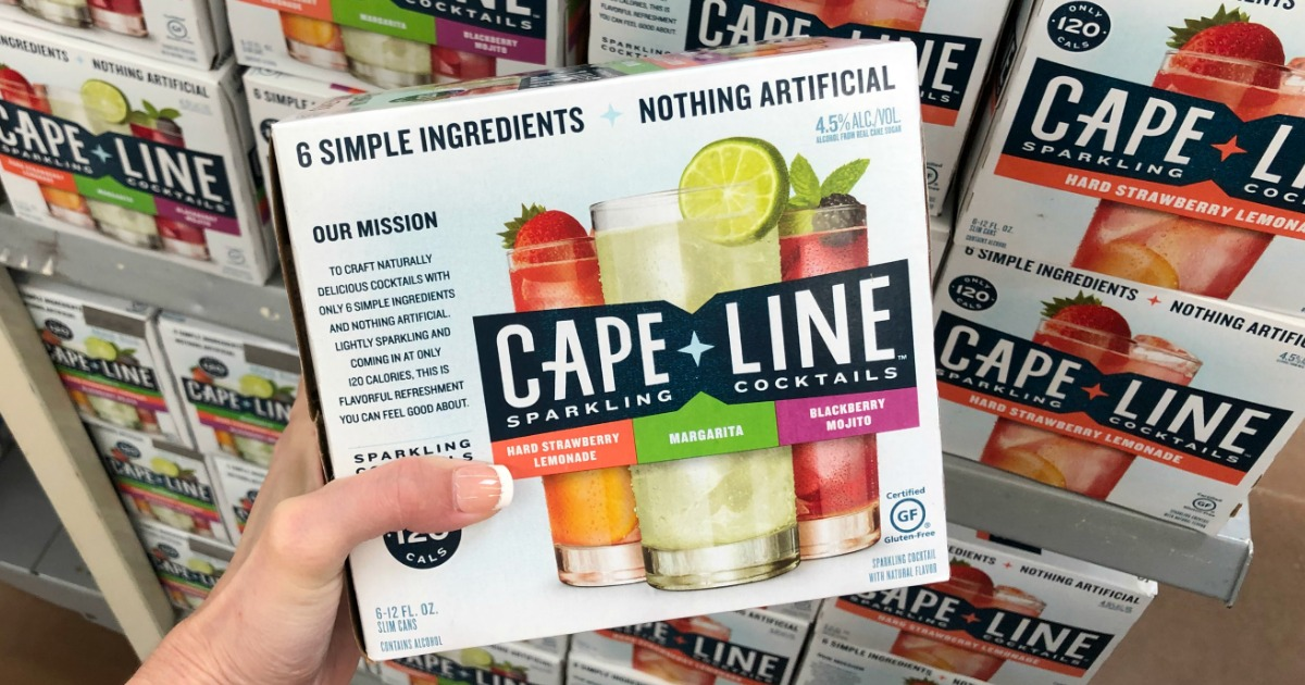 Woman holding Cape Line Sparkling Cocktails in Walmart store