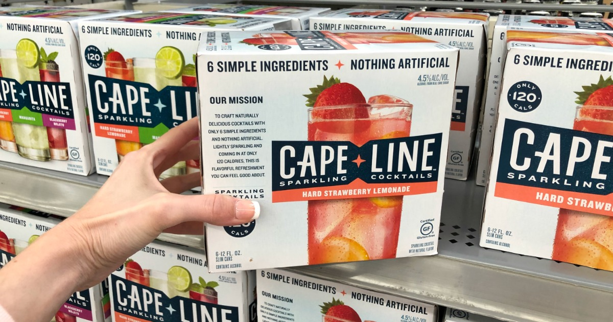 Woman holding Cape Line Strawberry Lemonade Sparking Cocktails in Walmart store