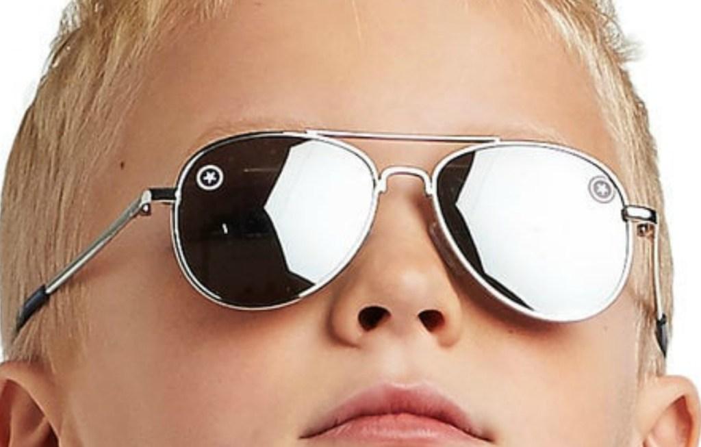 Boy wearing reflective glases