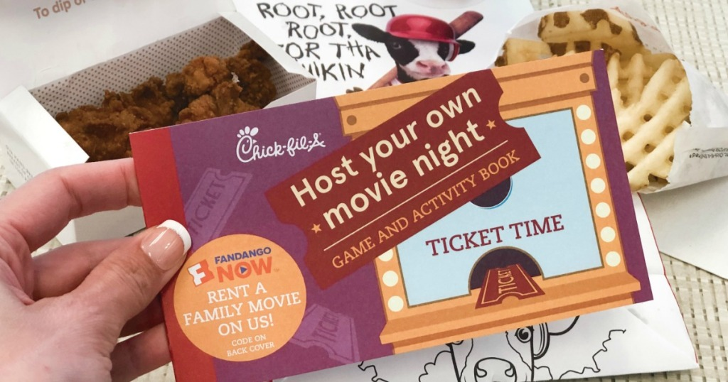 hand holding Chick-Fil-A activity booklet