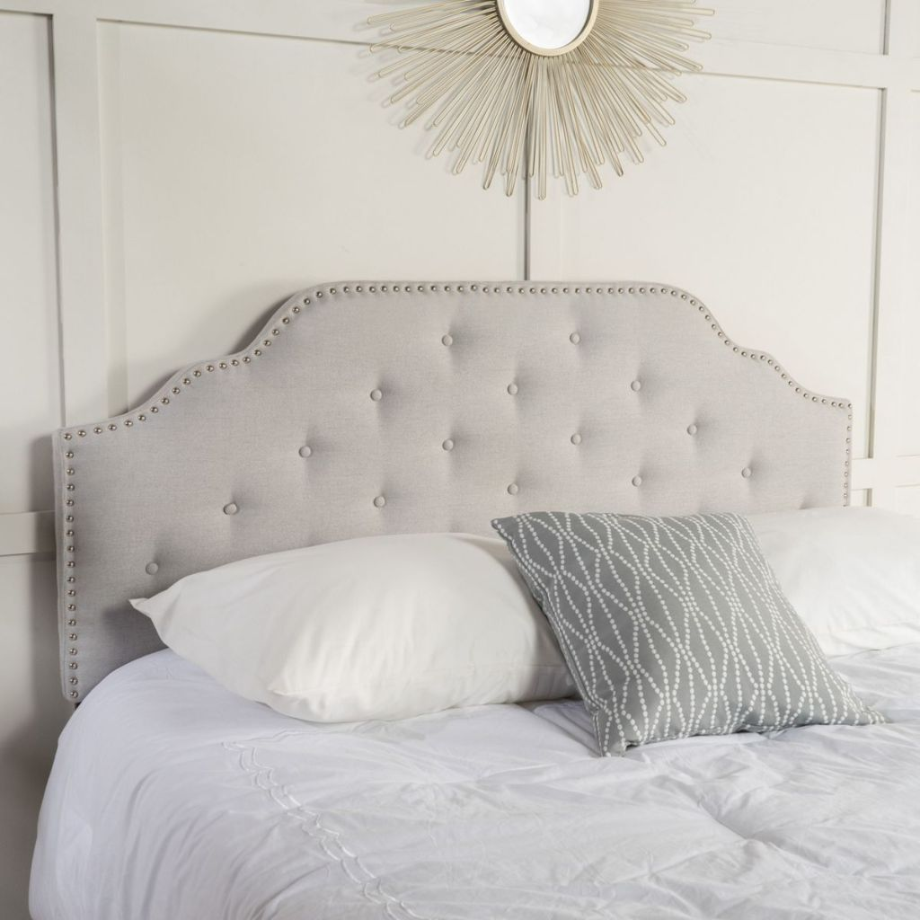 bed with pillows and headboard