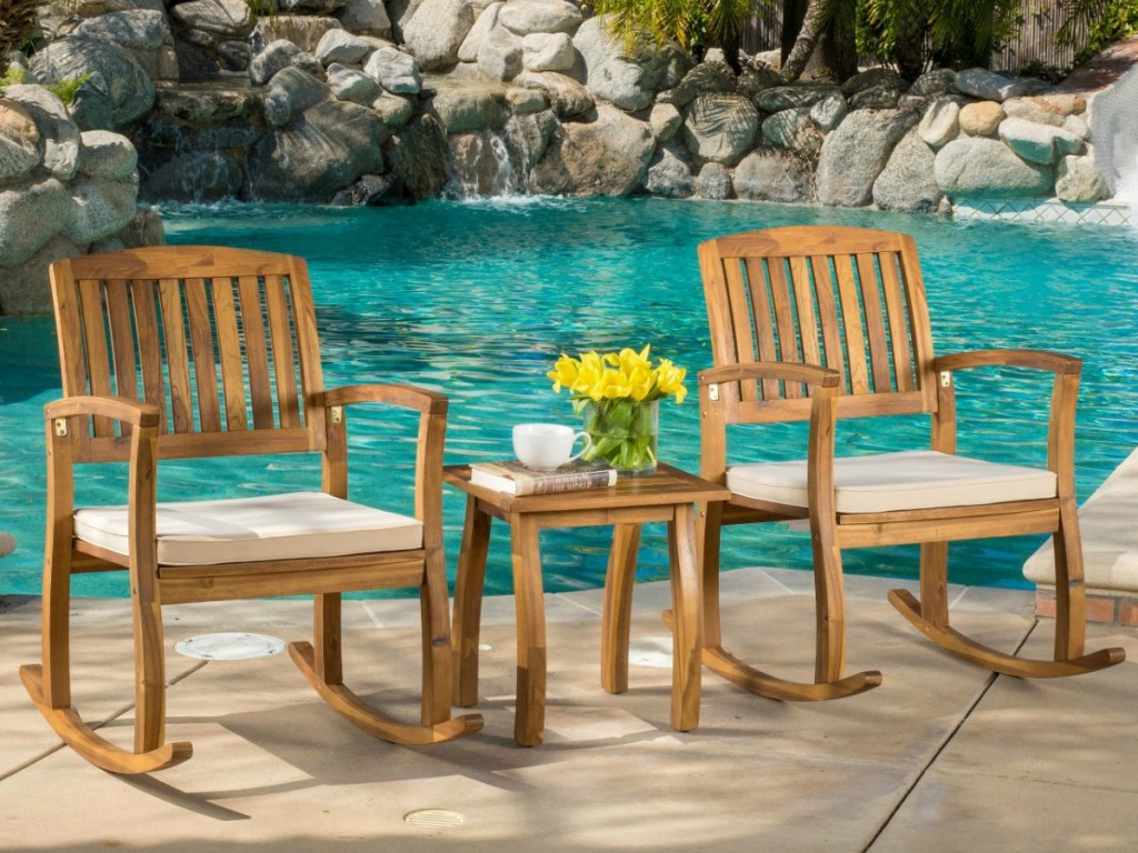 Christopher Knight Teak Rocking Chair Set in front of pool