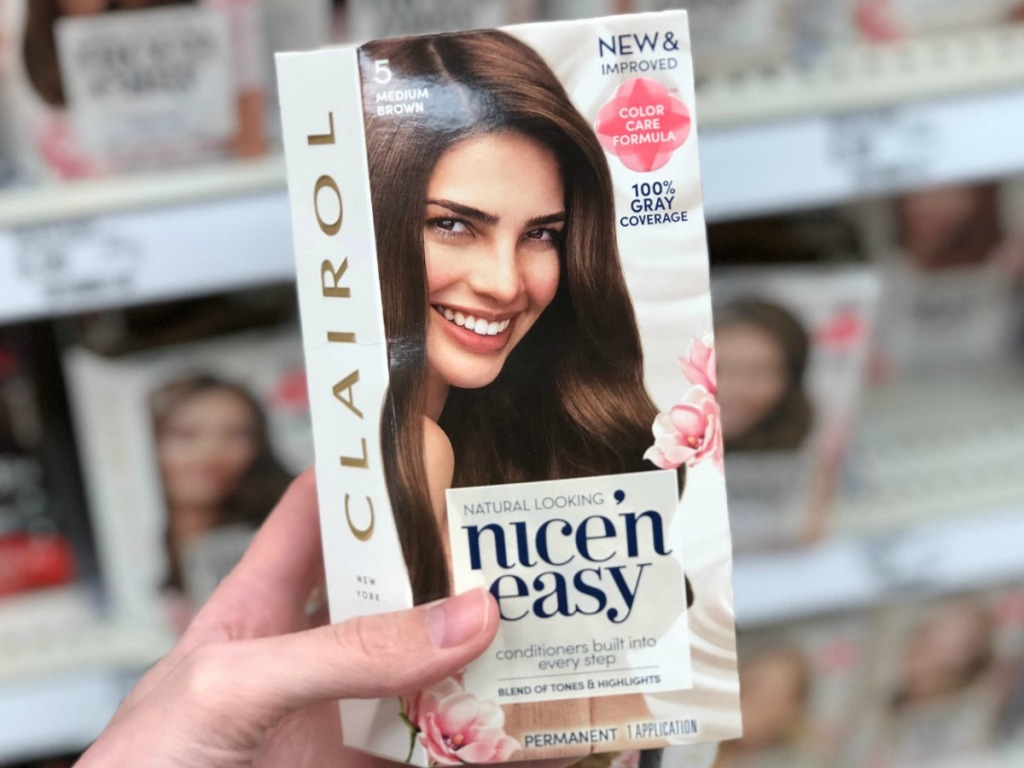 Woman's holding Clairol Nice N' Easy Hair Color