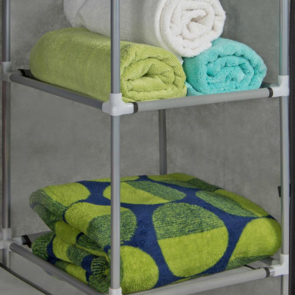 inside of best choice products closet with towels stacked