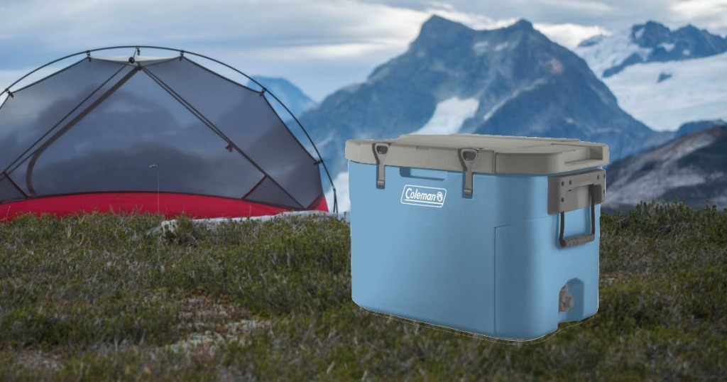 coleman cooler in front of tent at dusk