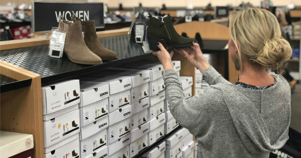 Collin looking at Sonima boots at Kohl's