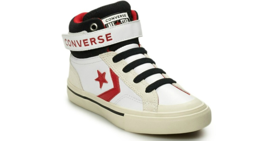 boy's white converse hightops with star and arrow