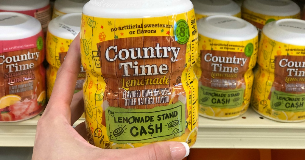 person holding Country Time lemonade