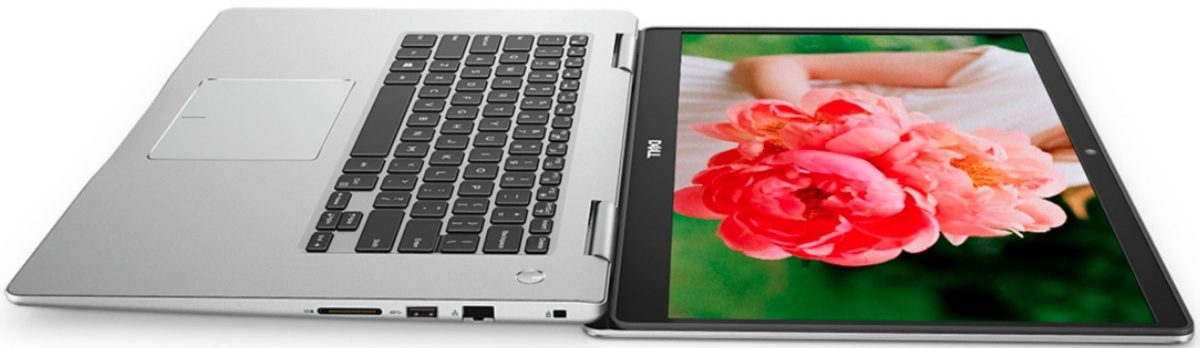 Dell laptop open with picture of woman holding pink flower on the screen