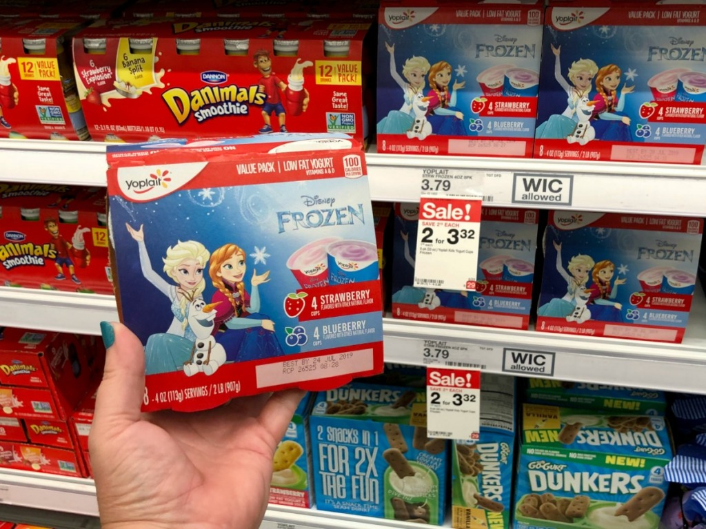 hand holding Disney Yoplait kids yogurt at Target
