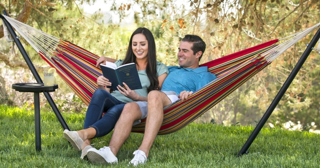 man and woman in Double Hammock Set w/ Stand, Cup Holder, Tray, and Carrying Bag