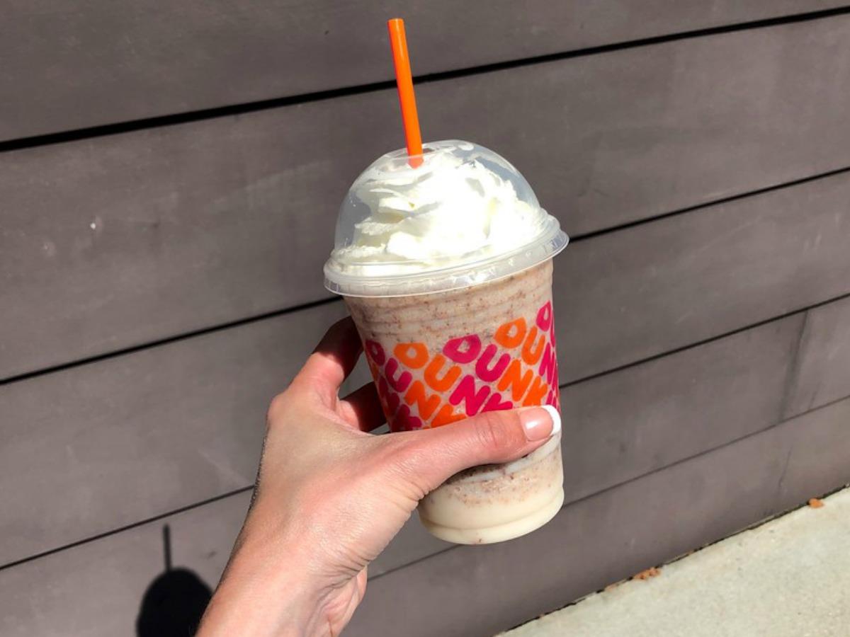 hand holding Dunkin frozen drink