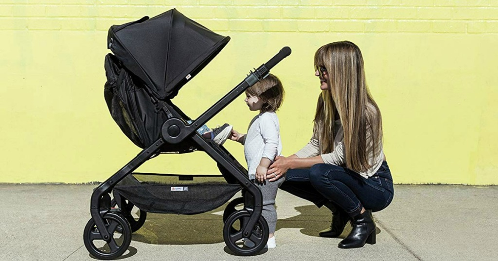 child and woman looking in stroller