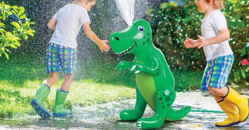 Kids playing in water squirting from Etna Green Inflatable Dinosaur Sprinkler