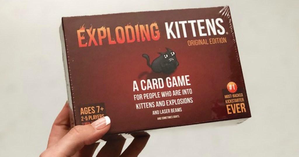 hand holding the Exploding Kittens game