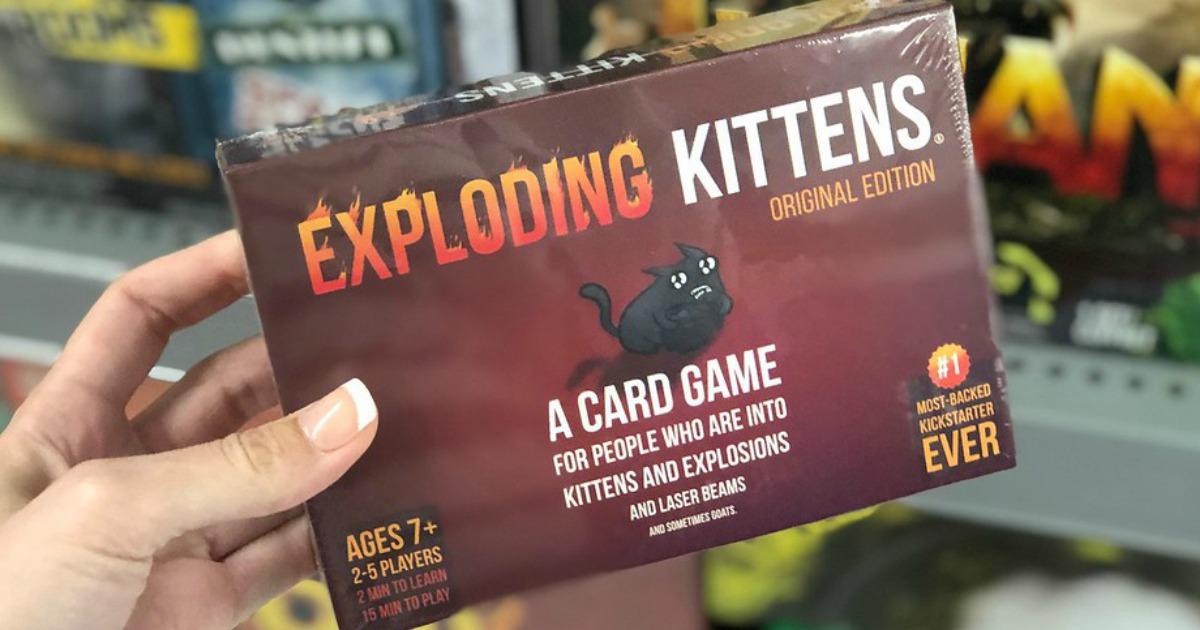 hand holding exploding kittens card game