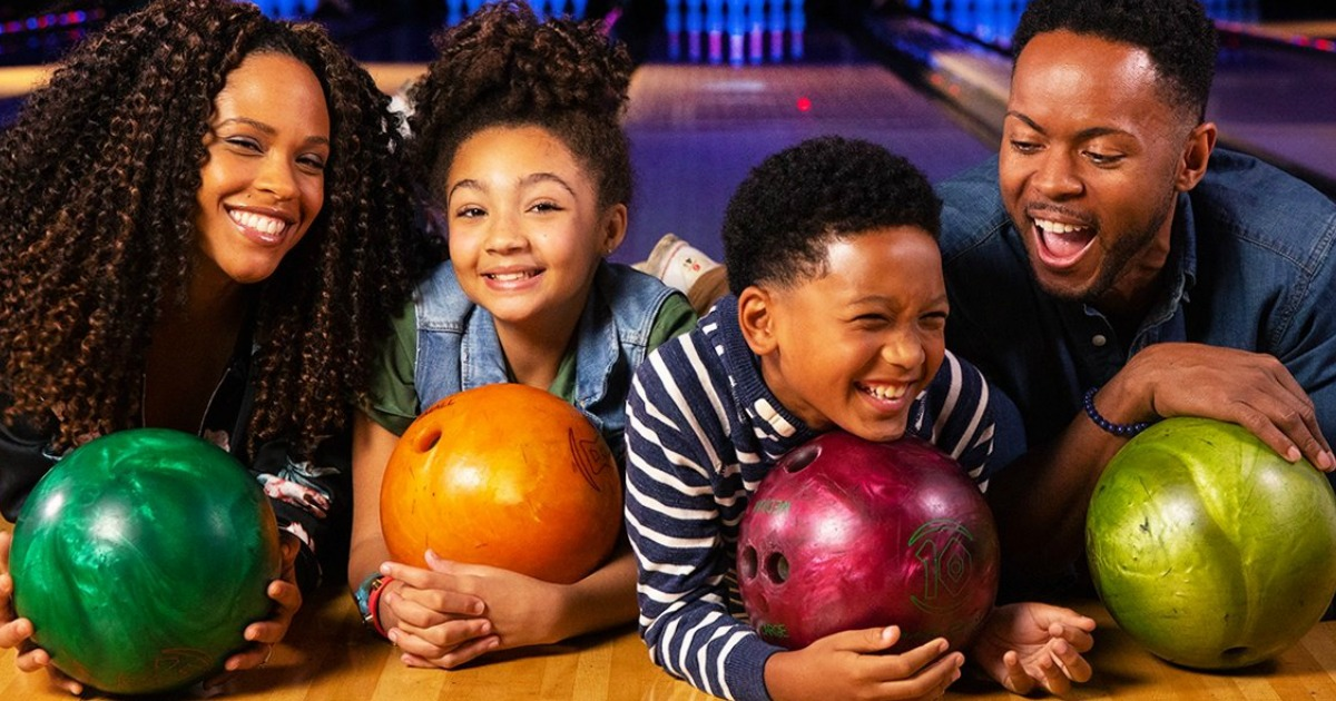 family with bowling balls