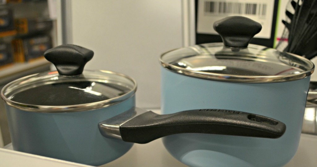 blue pots with lids on shelf