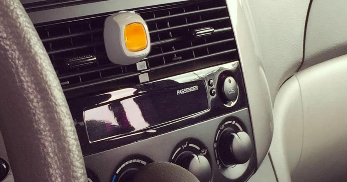 Febreze Car Vent Clip installed in a car