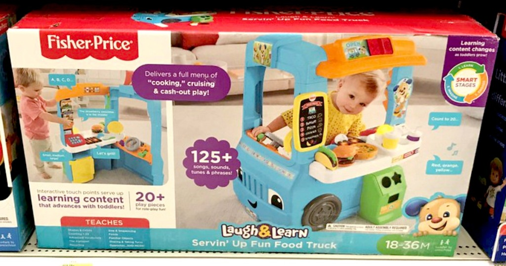 Fisher-Price Laugh and Learn Servin' Up Fun Food Truck in the box sitting on a shelf