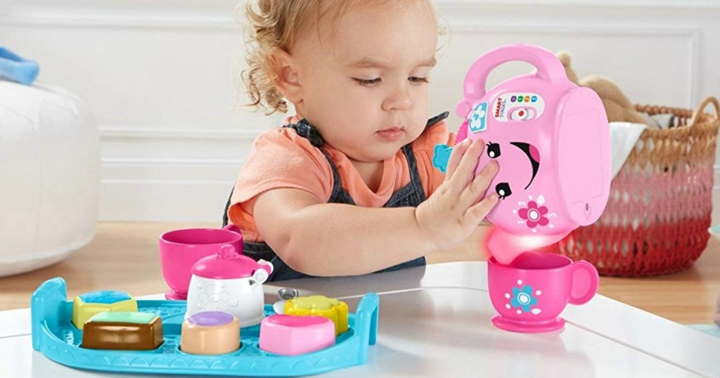 child playing with Fisher-Price Sweet Manners Tea Set