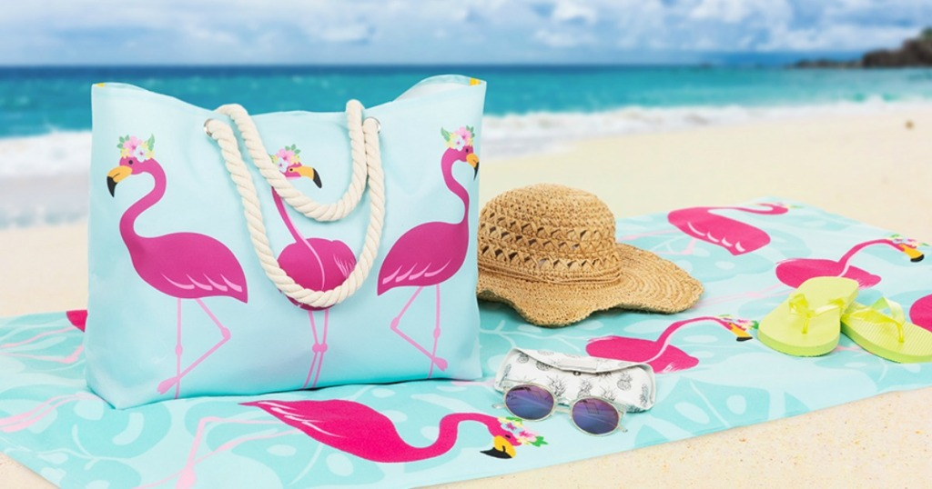 Flamingo towel on the beach with a matching flamingo tote