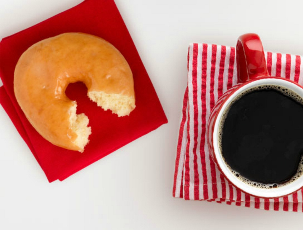 donut and coffee sitting on counter