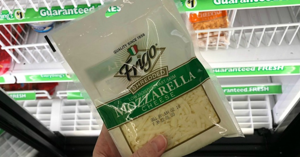 hand holding Frigo shredded cheese at Dollar Tree