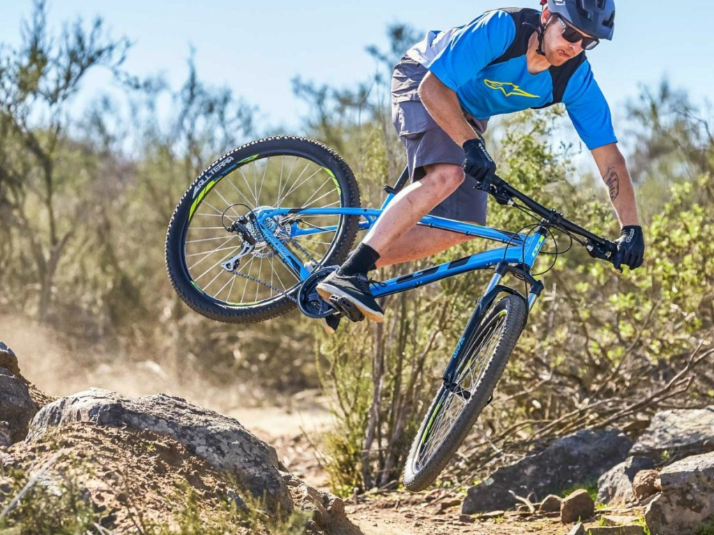 Man riding GT Aggressor Bike on outdoor trail
