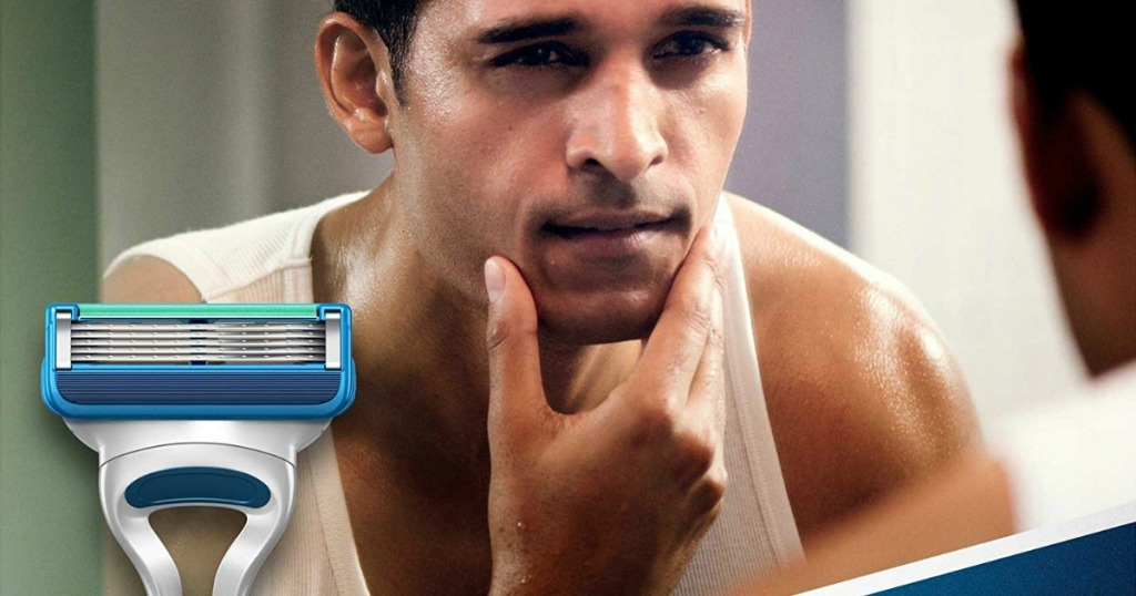 Gillette Sensor5 Men's Disposable Razor and man looking at reflection in mirror