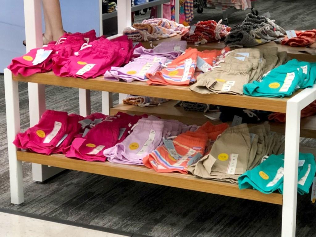 girls knit shorts folded on display shelf