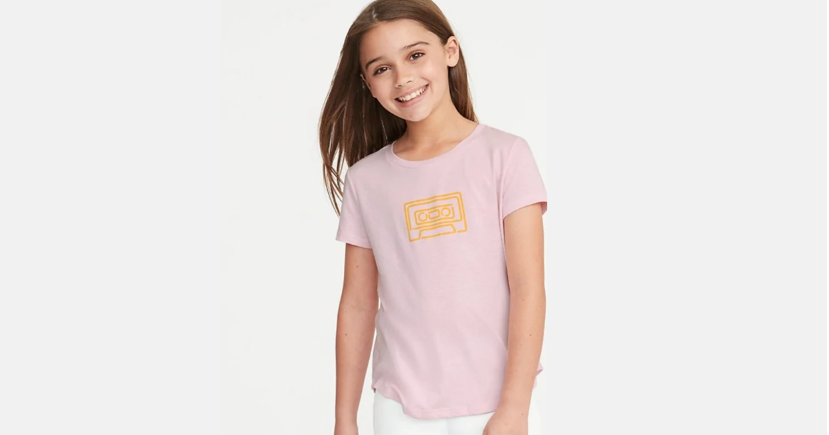 girl wearing pink and gold cassette tape shirt