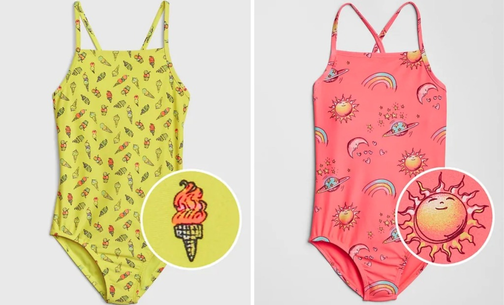 yellow one-piece swimsuit covered in ice cream icons next to to pink suit with rainbows, suns, moons, and planets