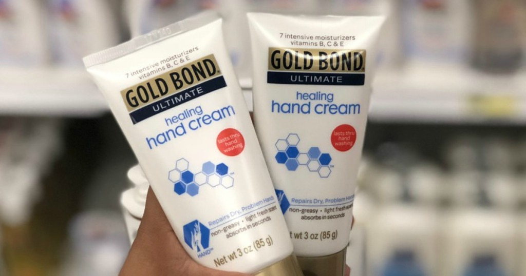 Two Gold Bond Healing Hand Creams being held