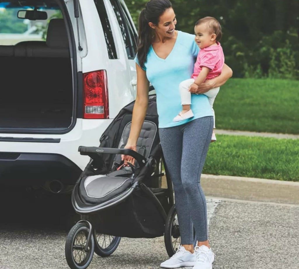 Woman with baby and jogging stroller