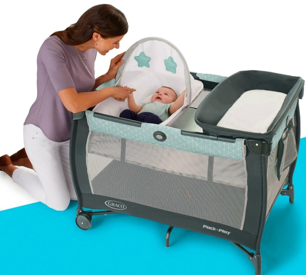 Mom with infant in graco pack n play