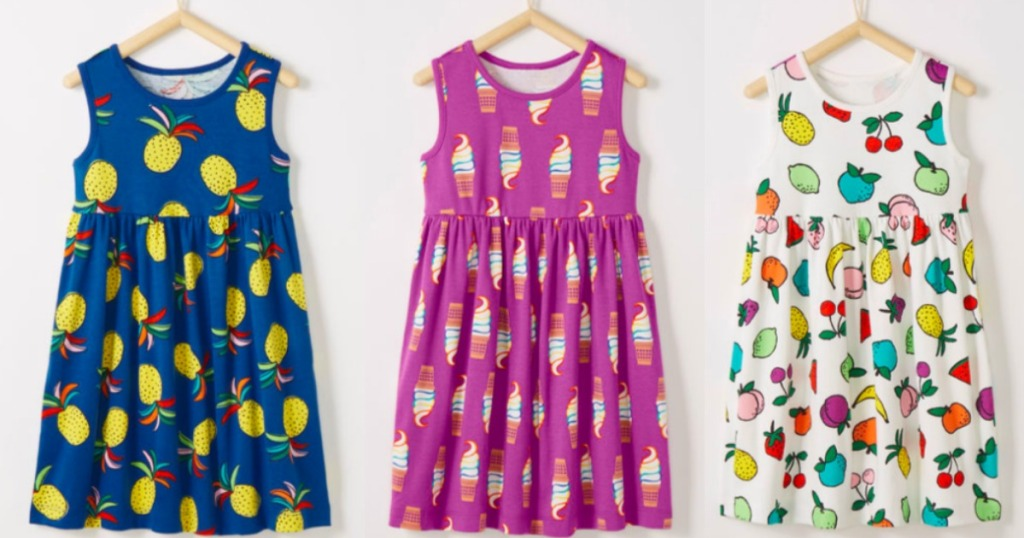 three colorful girls Hanna Andersson dresses next to each other