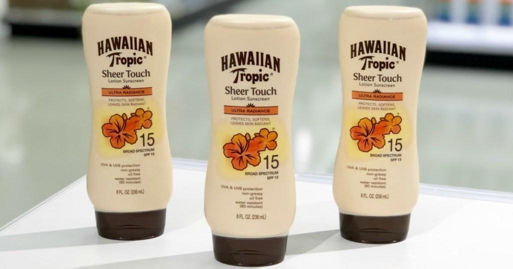 three Hawaiian Tropic Sheer Touch Sunscreen bottles