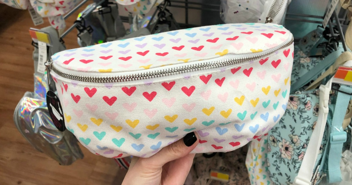 woman holding a Heart Fanny Pack at Walmart