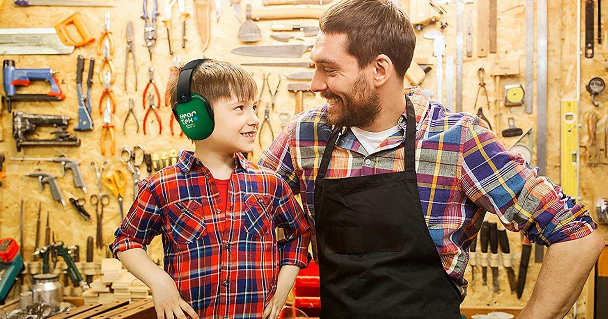 kid wearing earmuffs in workshop