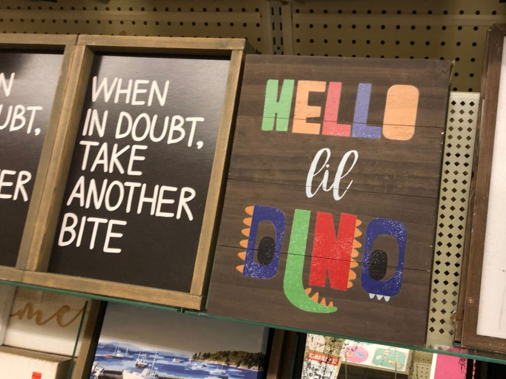 Hello Lil Dino Sign and When in doubt, take another bite sign at Hobby Lobby