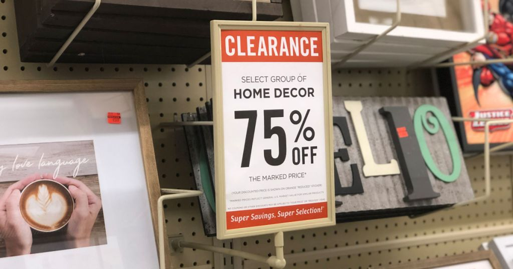 Clearance Home Decor sign in hobby lobby with decor signs behind it