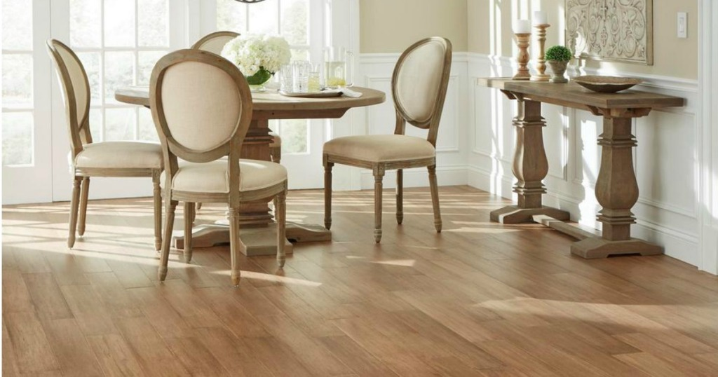 hardwood floors in a dining room with table, four chairs and a window