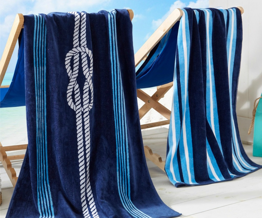 coastal beach towels hanging on chairs by the beach